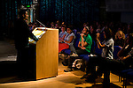 Kofi Hope from Toronto, Canada, speaks to the crowd during the opening of Powershift. The UKYCC PowerShift Conference, held on Oct. 9-12, brought together over 250 young people from across the United Kingdom and the world to discuss climate change. The conference taught them how to  organize, build a social movement and take creative and intelligent action to tackle the climate crisis. Institute of Education, London, United Kingdom (2009 ©Robert vanWaarden)