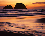 Tillamook County, OR  <br /> Sunset light silhouetting Three Arch Rocks from Oceanside Beach