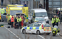 Police officers block off the area leading to the scene of a road traffic collision on Newport Bridge where paramedics and medical staff treat a female pedestrian after she was hit by a silver Ford Focus leaving her in a critical condition, Newport, south Wales, UK. Thursday 23 March 2017