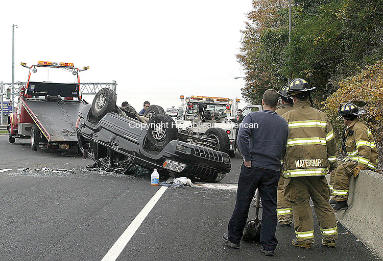 WATERBURY, CT -26 OCTOBER 2007 -102607DA06- Waterbury Firefighters respond to a one car rollover accident on Route 8 south between exits 29 and 30 in Waterbury on Friday. The accident is under investigation.<br /> Darlene Douty/Republican-American