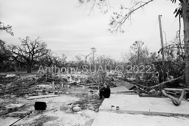 Waveland, Mississippi.USA.December 2, 2005 ..Hurricane Katrina damage and recovery along the coast. A resident returns home and sits on the foundation of her past home that she had for more then 30 years. She said it was like loosing a member of her family...