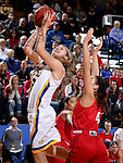 BROOKINGS, SD - JANUARY 17:  Macy Miller #12 from South Dakota State takes the ball to the basket against Tia Hemiller #4 from the University of South Dakota in the first half of their game Sunday afternoon at Frost Arena in Brookings, S.D. (Photo by Dave Eggen/Inertia)