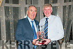 Kerry Athletics Awards Night: Donal Crowley of the Tralee Harriers club being presented with the Hall of Fame Award by Weeshie Fogarty at the Kerry Athletics Awards night at the Listowel Arms Hotel on Saturday night last.