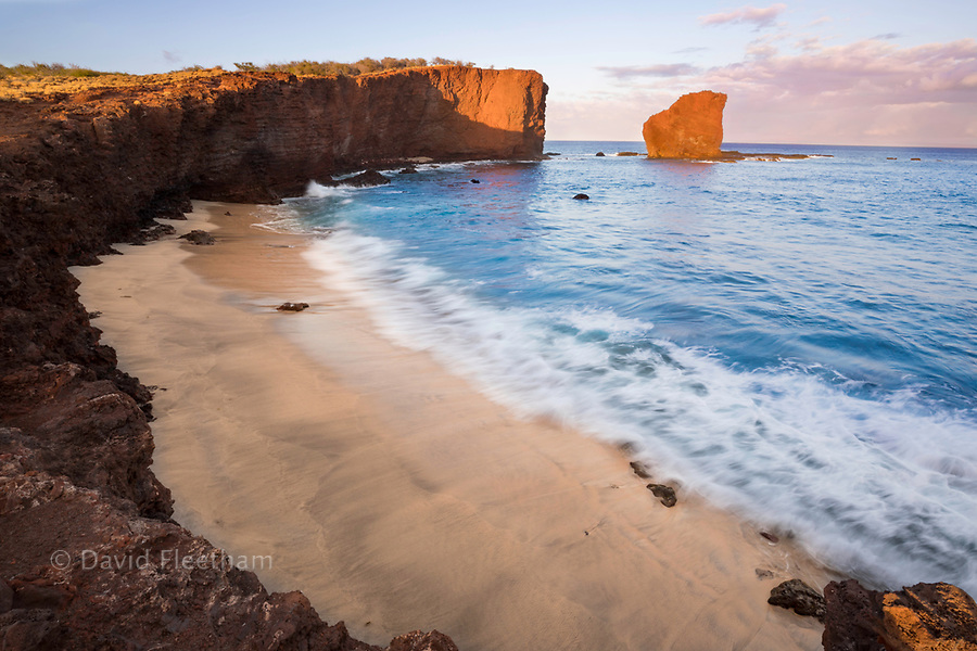 """Sunset light on the clouds above Puu Pehe Rock, also known as """"Sweetheart Rock"""", one of Lanai's most recognizable landmarks, Lanai Island, Hawaii, USA."""