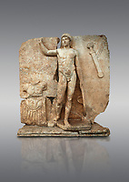 Roman Sebasteion relief  sculpture of Ares, Aphrodisias Museum, Aphrodisias, Turkey. <br /> <br /> The nude and classically7 styled young god wears only a helmet and holds a spear (missing) in one hand and a shield in the other. At the left stands cuirass, and at the upper right corner hangs his sword. Ares was a god of war and was not later defaced by Christians probably because he so closely resembles a young emperor.