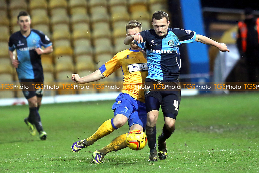 Josh Scowen of Wycombe tries to elude a challenge - Mansfield Town vs Wycombe Wanderers - Sky Bet League Two Football at the One Call Stadium, Mansfield - 25/01/14 - MANDATORY CREDIT: Paul Dennis/TGSPHOTO - Self billing applies where appropriate - 0845 094 6026 - contact@tgsphoto.co.uk - NO UNPAID USE