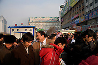 Crowds gather outside the Urumqi Railway Station in Urumqi, Xinjiang, China.