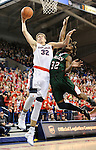 Dec 1, 2016; Spokane, WA, USA; Gonzaga Bulldogs forward Zach Collins (32) goes up for a basket against Mississippi Valley State Delta Devils forward Amos Given (32) during the first half at McCarthey Athletic Center. Mandatory Credit: James Snook-USA TODAY Sports
