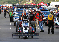 Jul. 19, 2013; Morrison, CO, USA: Crew members with NHRA top fuel dragster driver Scott Palmer during qualifying for the Mile High Nationals at Bandimere Speedway. Mandatory Credit: Mark J. Rebilas-