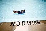 "Josha Mormant, 10, does a ""twist,"" a trick where he spins around in the water, in the May Park Pool in Augusta July 22, 2008. Richmond County Pools close next week. The last day to swim is August, 1, 2008. KENDRICK BRINSON/STAFF"