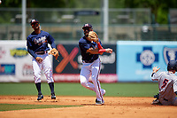 Mississippi Braves second baseman Alejandro Salazar (48) throws to first base as shortstop Ray-Patrick Didder (13) looks on during a Southern League game against the Jacksonville Jumbo Shrimp on May 5, 2019 at Trustmark Park in Pearl, Mississippi.  Mississippi defeated Jacksonville 1-0 in ten innings.  (Mike Janes/Four Seam Images)