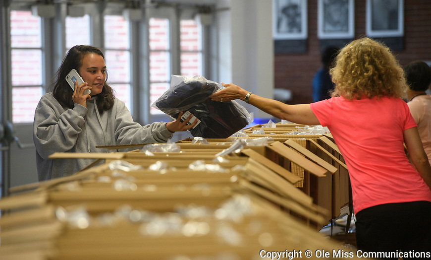 Students pickup their caps and gowns in preparation for Saturday's Commencement. Photo by Thomas Graning/Ole Miss Communications