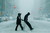 People try to make their way under the snow during the pass of the winter storm JONAS, in New York, 01/23/2016. Photo by VIEWpress