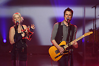 Quebec band Alfa Rococo (Justine Laberge at left and David Bussieres) performs during the telethon operation Enfant-Soleil held at the pavillon de la Jeunesse in Quebec city May 31, 2009. Operation Enfant-Soleil is the French-canadian version of the Children's Miracle Network (CMN), an international non-profit organization that raises funds for Children's hospitals, medical research and community awareness of children's health issues.