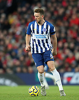 30th November 2019; Anfield, Liverpool, Merseyside, England; English Premier League Football, Liverpool versus Brighton and Hove Albion ; Dale Stephens of Brighton and Hove Albion controls the ball - Strictly Editorial Use Only. No use with unauthorized audio, video, data, fixture lists, club/league logos or 'live' services. Online in-match use limited to 120 images, no video emulation. No use in betting, games or single club/league/player publications