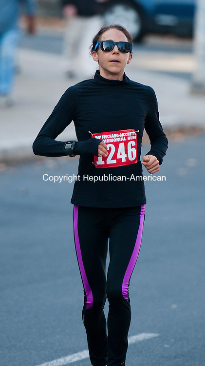 WATERBURY, CT-112314JS09-Christina Wickson of Newtown was the   top female finisher in the 5-Mile group during the annual Fischang-Cicchetti Race Sunday in downtown Waterbury. <br /> Jim Shannon Republican-American