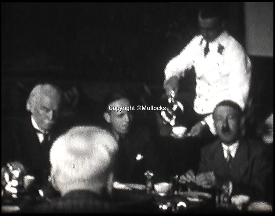 BNPS.co.uk (01202 558833)<br /> Pic: BNPS<br /> <br /> Film footage of Lloyd George chatting to Hitler at his home in the Bavarian alps.(Not part of the sale)<br /> <br /> A personal portrait Adolf Hitler gave to former Prime Minister David Lloyd George during his controversial visit to see the German dictator in 1936 has emerged for sale for £22,000.<br /> <br /> The Liberal politician struck up an unlikely friendship with the Nazi ruler during the trip to the Bavarian Alps and even declared him the 'greatest living German.'<br /> <br /> In return, Hitler presented pro-German Lloyd George with a large signed photograph of himself. <br /> <br /> The image is now being sold by Dominic Winter Auctioneers of Cirencester.