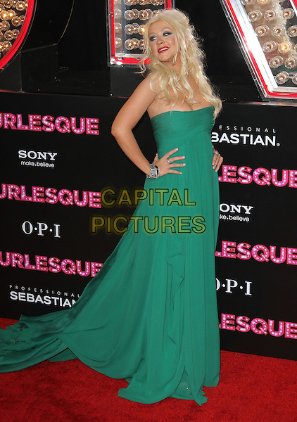 CHRISTINA AGUILERA.'Burlesque' Los Angeles Premiere held at The Grauman Chinese Theatre, Hollywood, CA, USA. .November 15th, 2010.full length strapless green dress long hands on hips maxi bracelets .CAP/ADM/KB.©Kevan Brooks/AdMedia/Capital Pictures.