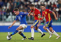 Italy Andrea Belotti, left, is challenged by Spain Sergio Ramos, center, and Koke, during the Fifa World Cup 2018 qualification soccer match between Italy and Spain at Turin's Juventus Stadium, October 6, 2016. The game ended 1-1.<br /> UPDATE IMAGES PRESS/Isabella Bonotto