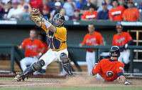 Virginia's David Coleman (9) slides home before Cal catcher Chadd Krist can get the ball. Virginia beat Cal 8-1 at the College World Series on June 23, 2011 in Omaha, Neb. (Photo by Michelle Bishop)..