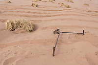 The tool that Chinese afforestation workers use to prepare the ground before poking straw partway into the sand, forming a pattern of small squares in the desert areas of Minqin county in Gansu province, October 2016. The grid like network of straw fences break the force of the wind at ground level, stopping dune movement by confining the sand within the squares of the grid. Minqin county is located in between the Tengger Desert and the Badain Jaran Desert.