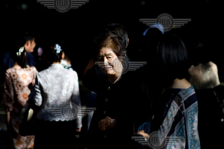 An elderly woman attends a Shinto wedding at the Meiji Jingu Shinto Shrine. /Felix Features