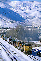 Mixed train in snow-covered mountains