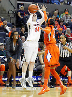 Former Virginia player and Clemson head coach Audra Smith tries to throw off Virginia guard Lexie Gerson (14) as she shoots the ball over  Clemson guard Chancie Dunn (23) during the game Sunday in Charlottesville, VA. Photo/The Daily Progress/Andrew Shurtleff