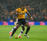 27th December 2019; Molineux Stadium, Wolverhampton, West Midlands, England; English Premier League, Wolverhampton Wanderers versus Manchester City; Adama Traore of Wolverhampton Wanderers with the ball at his feet as Raheem Sterling of Manchester City tackles - Strictly Editorial Use Only. No use with unauthorized audio, video, data, fixture lists, club/league logos or 'live' services. Online in-match use limited to 120 images, no video emulation. No use in betting, games or single club/league/player publications