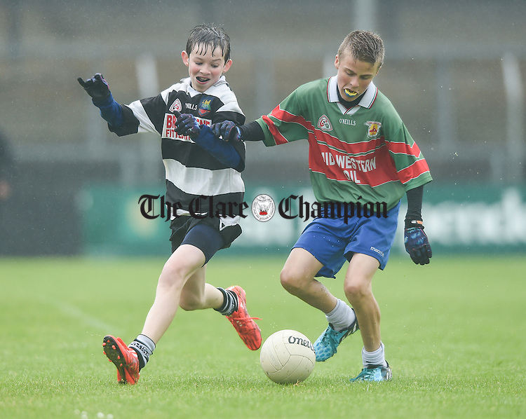 Clarecastle's James Kelly in action against Eoin Guilfoyle of Clooney-Quin during the U-12 football finals in Cusack park. Photograph by John Kelly.