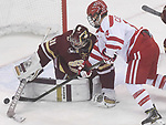 (Boston MA 01/13/7)	BC goalie 31, Joseph Woll, stops this shot on goal from BU 14, nBobo Carpenter, in the first half of the game at Boston University, Friday, January 13, 2017, in Boston. Herald Photo by Jim Michaud