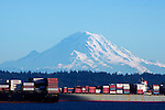 Cargo Tankers are dwarfed by Mt. Rainier as they lie in wait  to be offloaded as disagreements between the International Longshore & Warehouse Union (ILWU) and the Pacific Northwest ports over union contracts have resulted in work slowdowns in the loading and unloading of cargo at the Ports of Tacoma and Seattle since November 2014.  Arriving cargo container ships are beginning to stack up are being moored over in Manchester Bay near the Kitsap Peninsula on February 17, 2015. ©2015 Jim Bryant Photo. All RIghts Reserved