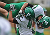 Neil Levantini #44 of Farmingdale, bottom, hoists Justin Steinheimer #19 into the air after their team's 41-27 win over host Massapequa High School in a Nassau County Conference I varsity football game on Saturday, Sept. 22, 2018.