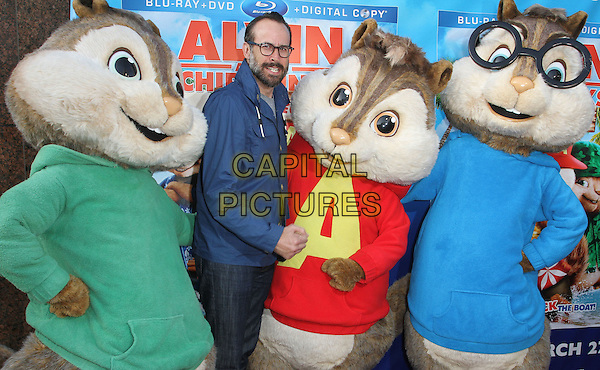 "Jason Lee & The Chipmunks.The Twentieth Century Fox Home Entertainment's ""Alvin And The Chipmunks: Chipwrecked"" Blu-ray And DVD Release Party Held At The El Rey Theatre, Los Angeles, California, USA..March 26th, 2012.half length blue shirt glasses costume alvin simon theodore beard facial hair .CAP/ADM/FS.©Faye Sadou/AdMedia/Capital Pictures."