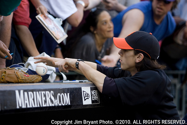 San Francisco Giants pitcher Tim Lincecum signs autographs before their game against the Seattle Mariners at SAFECO Field in Seattle May 22, 2009.     Jim Bryant Photo. ©2010. All Rights Reserved