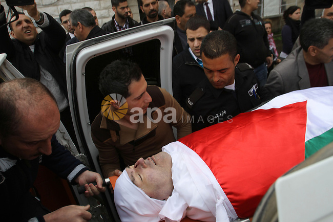 "Palestinians carry the body of Raed Zeiter, 38, during his funeral in the northern West Bank city of Nablus, on March 11, 2014, a day after he was shot dead by the Israeli military. The Jordanian-Palestinian judge was shot by Israeli troops at the Allenby Bridge border crossing between the West Bank and Jordan, after he allegedly tried to snatch a weapon and ""strangle"" an Israeli soldier, a preliminary Israeli army investigation showed. Photo by Nedal Eshtayah"