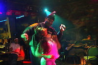 10/23/03 crab NWS::  Ralph Harvey, a cargo agent for Penn Air Alaska Airlines, dances with Barbara Miles at Carls, a bar in Unalaska, AK.