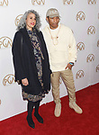 HOLLYWOOD, CA - JANUARY 28: Producer Mimi Valdes (L) and singer-songwriter-rapper-producer Pharrell Williams arrive at the 28th Annual Producers Guild Awards at The Beverly Hilton Hotel on January 28, 2017 in Beverly Hills, California.