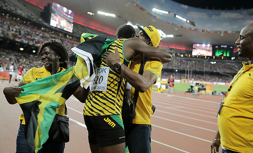 22.08,2015. Beijing, China.   Usain Bolt of Jamaica hugs his father Wellesley Bolt next to his mother Jennifer Bolt (L) and his business manager Norman Peart after winning the Men's 100 M Final at the 15th International Association of Athletics Federations (IAAF) Athletics World Championships in Beijing, China, 23 August 2015.