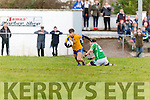 Darragh Coffey Beaufort turns Paul carroll Milltown Castlemaine as he sets his eye for goal during the Mid Kerry final in Killorglin on Sunday