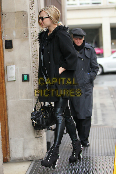 Fearne Cotton arrives for work, London, England..October 17th, 2012.full length black coat jacket top leather leggings trousers sunglasses shades bag purse pregnant hand in pocket boots side profile .CAP/HIL.©John Hillcoat/Capital Pictures .