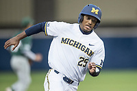 Michigan Wolverines outfielder Johnny Slater (25) rounds third base headed home against the Michigan State Spartans on May 19, 2017 at Ray Fisher Stadium in Ann Arbor, Michigan. Michigan defeated Michigan State 11-6. (Andrew Woolley/Four Seam Images)