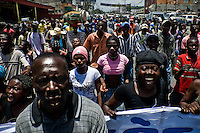 People shout and protest against the government on a wild and violent riot in the centre of Port-au-Prince, Haiti, 15 July 2008. Haitian administration and the judicial system are (and always have been) higly corrupted, misappropriation of public funds is common. The overall situation on Haiti gets worse every year and the extreme, hardly imaginable poverty hits more and more people. The Haitian economics is paralysed, there is no infrastructure, no food supplies, the population suffer from hunger, social and living conditions in Haitian slums (e.g. Cité Soleil) are a human tragedy. The rage grows and the tension continues with undiminished strength.