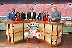 ESPN College Gameday staff from right to left, Desmond Howard, Erin Andrews, Chris Fowler, Lee Corso, and Kirk Herbstreit on the set at Camp Randall Stadium prior to the Wisconsin Badgers NCAA college football game against the Ohio State Buckeyes on October 16, 2010 at Camp Randall Stadium in Madison, Wisconsin.(Photo by David Stluka)
