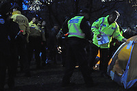 November 23, 2011, Toronto Police in significant numbers deploy during the predawn hours this morning, beginning the process of evicting the Occupy Toronto tent camp from St. James Park.  Here Police and city workers place a numbered sign on a protest tent prior to it's being removed.