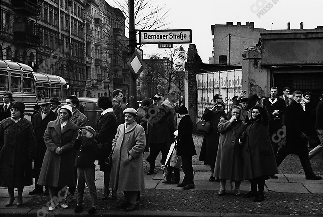 West Berliners looking east on a Saturday afternoon near the berlin wall, West Berlin, Germany, 1961