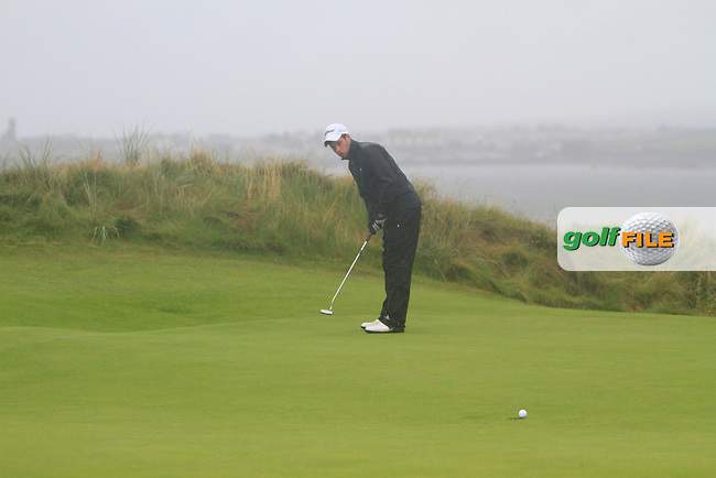Alex Gleeson (Castle) on the 6th green with a birdie put during the South of Ireland Amateur Open Championship Semi-Finals at Lahinch Golf Club  31th July 2013 <br /> Picture:  Thos Caffrey / www.golffile.ie