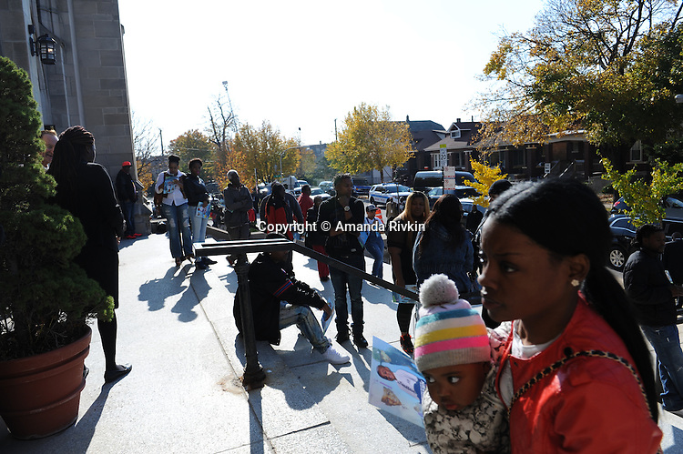 People gather on the steps of St. Sabina's during the funeral of Tyshawn Lee, 9, who was shot multiple times while playing basketball in an alley on November 2, 2015, in Chicago, Illinois on November 10, 2015. Police allege the killing was a retaliatory gang hit which would mark a new turn in Chicago's gang wars.