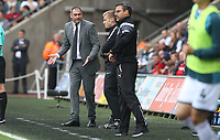 Swansea City manager Paul Clement disputes with Huddersfield Town manager David Wagner during the Premier League match between Swansea City and Huddersfield Town at The Liberty Stadium, Swansea, Wales, UK. Saturday 14 October 2017
