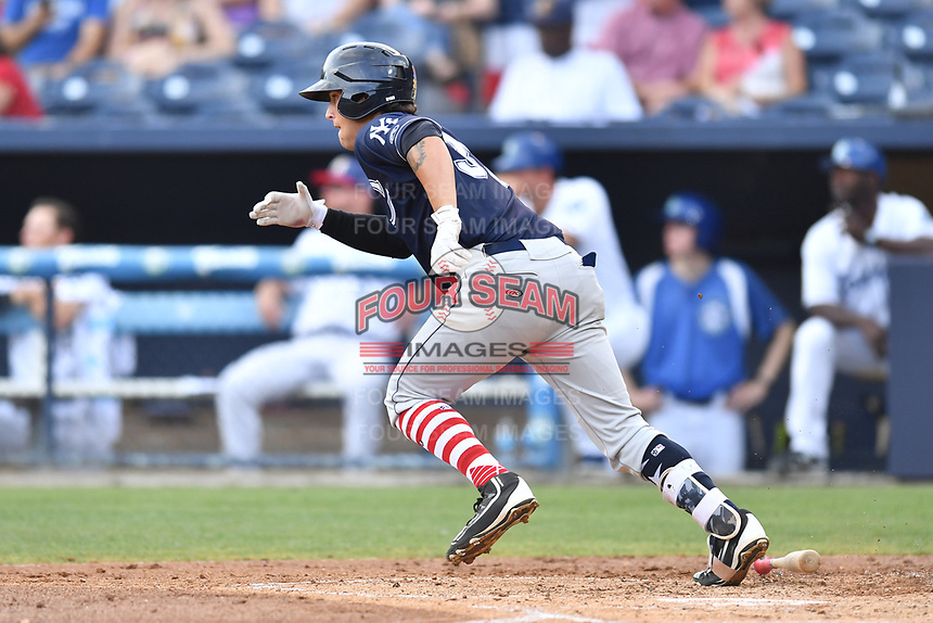 Charleston RiverDogs first baseman Brandon Wagner (33) runs to first base during a game against the Asheville Tourists at McCormick Field on July 4, 2017 in Asheville, North Carolina. The Tourists defeated the RiverDogs 2-1. (Tony Farlow/Four Seam Images)